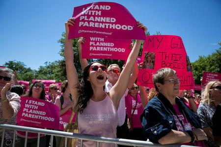 Claire Contreras reacts as she listens to Former State Senator Wendy Davis speak during a Planned Parenthood rally outside the State Capitol in Austin