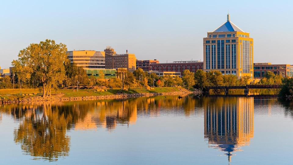 Reflection of downtown Wausau, Wisconsin in the Wisconsin River in Late summer.