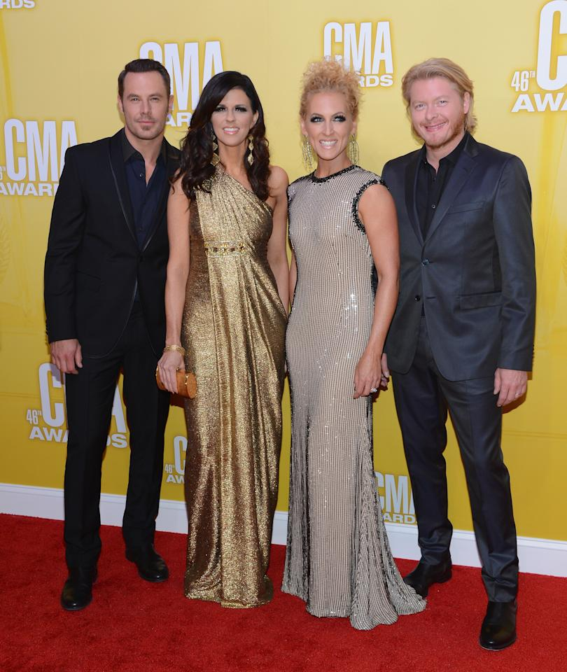 Little Big Town's band members – (L-R) Jimi Westbrook, Karen Fairchild, Kimberly Schlapman, and Phillip Sweet – color-coordinated for the country music celebration. While the gals shimmered in golden gowns, the guys sported head-to-toe black.