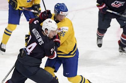 Christoffer Ehn (26) of Sweden and Auston Matthews of the US are seen in action during the 2016 IIHF World Junior Ice Hockey Championship bronze medal game in Helsinki, Finland, January 5, 2016. REUTERS/Markku Ulander/Lehtikuva ATTENTION EDITORS - THIS IMAGE WAS PROVIDED BY A THIRD PARTY. FOR EDITORIAL USE ONLY. NOT FOR SALE FOR MARKETING OR ADVERTISING CAMPAIGNS. THIS PICTURE IS DISTRIBUTED EXACTLY AS RECEIVED BY REUTERS, AS A SERVICE TO CLIENTS. NO THIRD PARTY SALES. NOT FOR USE BY REUTERS THIRD PARTY DISTRIBUTORS. FINLAND OUT. NO COMMERCIAL OR EDITORIAL SALES IN FINLAND.