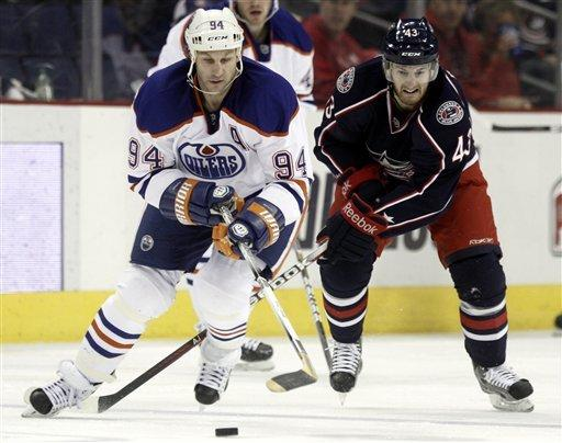 Edmonton Oilers' Ryan Smyth, left, and  Columbus Blue Jackets' Darryl Boyce chase the puck in the second period of an NHL hockey game, Sunday, March 25, 2012, in Columbus, Ohio. (AP Photo/Paul Vernon)