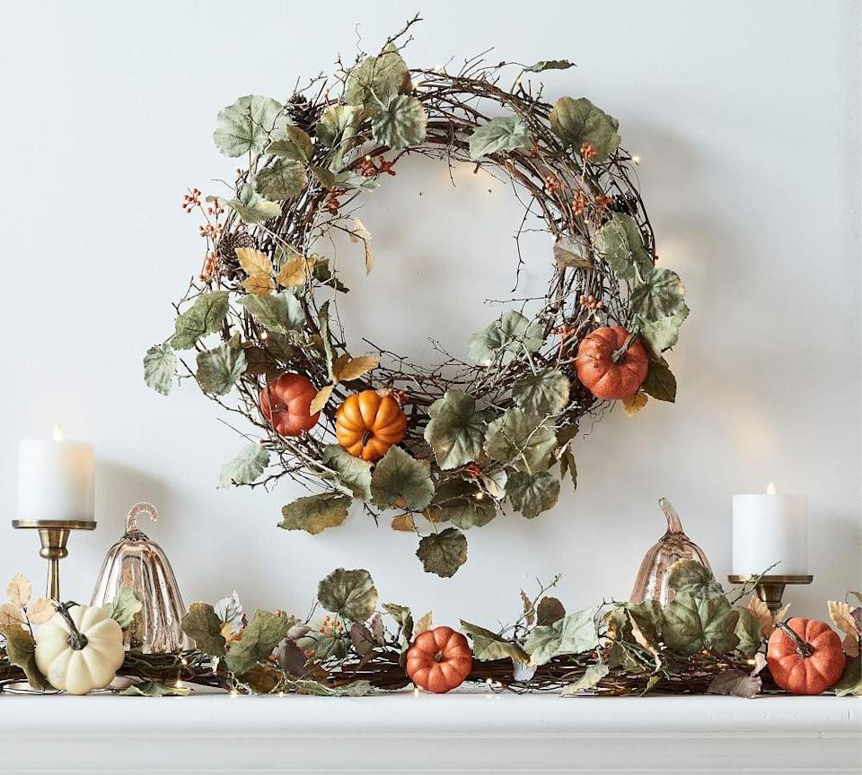 <p>Welcome in the season with this tasteful <span>Pottery Barn Lit Natural Pumpkin Wreath &amp; Garland</span> ($129-$149). Whether you choose to dress your front door or entryway with it, watch your guests shower you with compliments. </p>