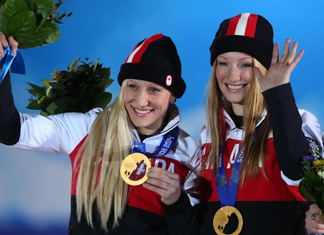 SOCHI, RUSSIA - FEBRUARY 20: Gold medalists Kaillie Humphries (L) and Heather Moyse of Canada team 1 celebrate during the medal ceremony for the Women's Bobsleigh on day thirteen of the Sochi 2014 Winter Olympics at at Medals Plaza on February 20, 2014 in Sochi, Russia. (Photo by Alexander Hassenstein/Getty Images)