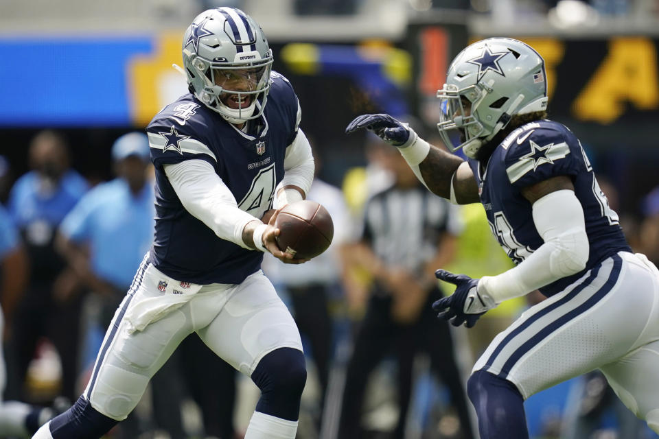 FILE - In this Sunday, Sept. 19, 2021, file photo, Dallas Cowboys quarterback Dak Prescott (4) hands off to running back Ezekiel Elliott during the first half of an NFL football game in Inglewood, Calif. So much has changed in the two years since the Cowboys and New England Patriots last met In their 2019 matchup of New England's top-ranked defense and Dallas' top-ranked offense. (AP Photo/Ashley Landis, File)