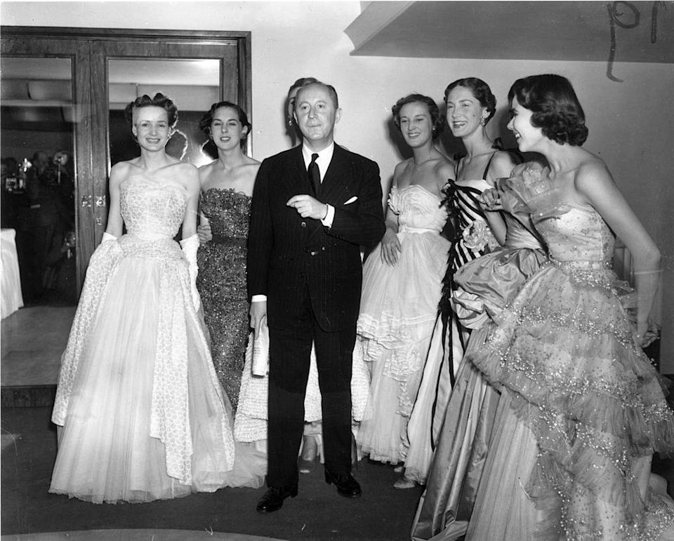 Christian Dior with a group of models wearing his looks