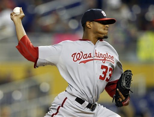 Washington Nationals starting pitcher Edwin Jackson throws in the first inning of a baseball game against the Miami Marlins, Tuesday, May 29, 2012, in Miami. (AP Photo/Lynne Sladky)