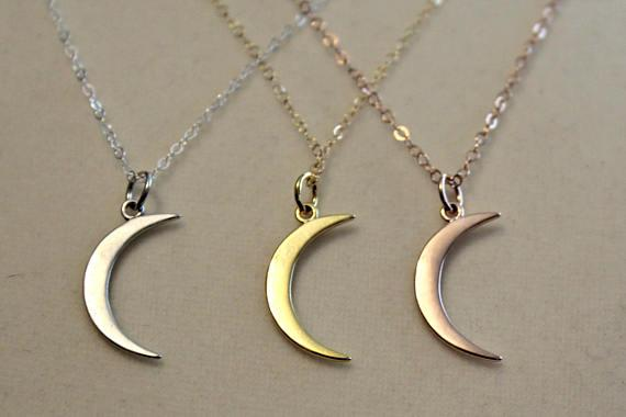 "<p>Forget playing Santa — be Jack Pearson this holiday season! Like the dreamy dad from <em>This Is Us</em>, bestow this delicate moon-shaped necklace on the love of your life. It comes in gold, rose gold, or silver. The three adorable kids come separately.<br /><strong>Buy: <a rel=""nofollow"" href=""https://www.etsy.com/listing/514043116/this-is-us-moon-necklace-mandy-moore?gpla=1&gao=1&&utm_source=google&utm_medium=cpc&utm_campaign=shopping_us_b-jewelry-necklaces-other&utm_custom1=f4f045dd-a619-4553-8066-a5e48577a31f&gclid=EAIaIQobChMIyb3Dgdff1gIVQh2BCh3K-g7-EAkYByABEgJwrvD_BwE&source=aw&utm_source=affiliate_window&utm_medium=affiliate&utm_campaign=us_location_buyer&awc=6220_1510608311_b28bcc55e54d468783ffb83de7ecdfc5&utm_content=202819"">Etsy/JWhiz</a></strong> </p>"