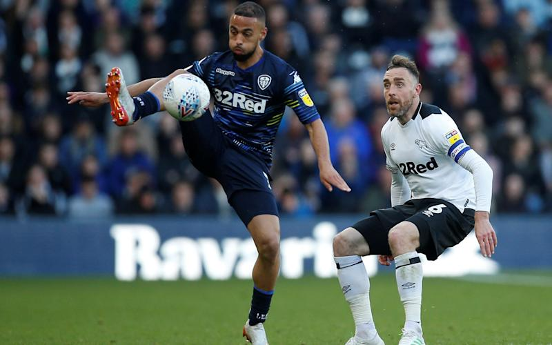 Leeds United's Kemar Roofe in action with Derby County's Richard Keogh - Action Images via Reuters/Craig Brough