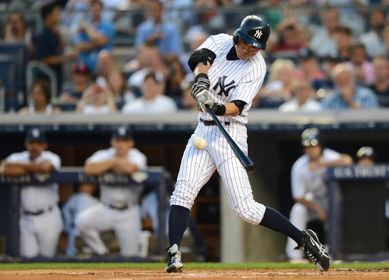 NEW YORK, NY - AUGUST 21: Ichiro Suzuki #31 of the New York Yankees gets his 4,000th career hit on a single in the 1st inning of the New York Yankees game against the Toronto Blue Jays at Yankee Stadium on August 21, 2013 in the Bronx borough of New York City. (Photo by Ron Antonelli/Getty Images)