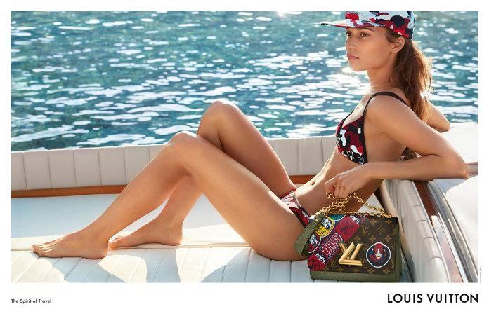 Alicia Vikander shows off her petite figure in a skimpy bikini posing on a boat for the new Louis Vuitton Cruise 2018 collection. Source: Louis Vuitton