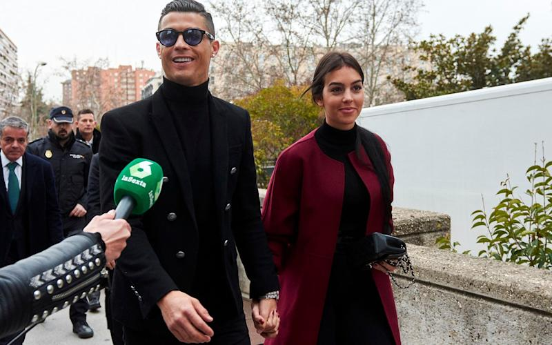 Cristiano Ronaldo with his girlfriend Georgina Rodriguez ahead of a separate court hearing for tax evasion - GC Images