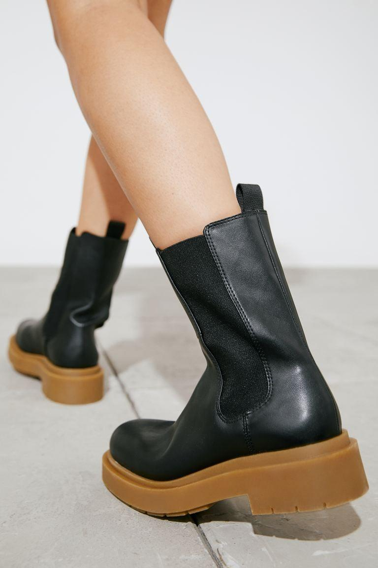 <p>Want to try something different? Get the <span>H&amp;M Platform Chelsea-style Boots</span> ($50) with a cool two-tone look and comfy sole.</p>