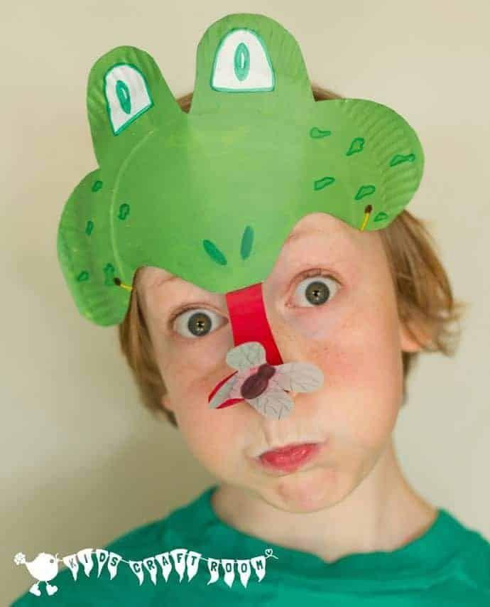 """<p>Complete with a tongue catching a fly, this paper plate frog mask will make everyone else green with envy. </p><p><strong><em>Get the tutorial at <a href=""""https://kidscraftroom.com/paper-plate-frog-mask-animal-mask/"""" rel=""""nofollow noopener"""" target=""""_blank"""" data-ylk=""""slk:Kids Craft Room"""" class=""""link rapid-noclick-resp"""">Kids Craft Room</a>. </em></strong></p>"""