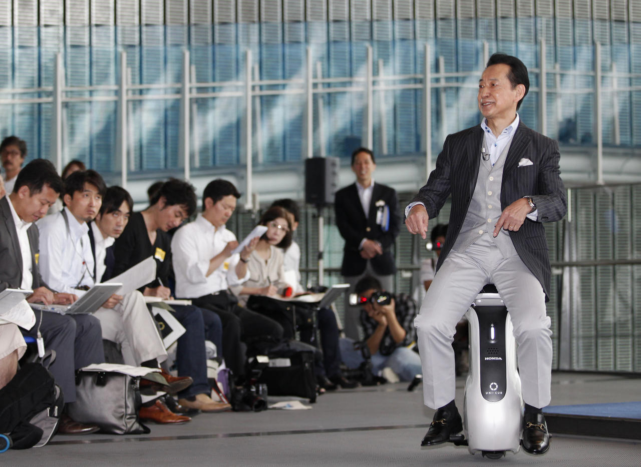 Mamoru Mori, Executive Director of National Museum of Emerging Science and Innovation (Miraikan) and former astronaut, rides Honda Motor Co's new UNI-CUB personal mobility device at the museum in Tokyo May 15, 2012. Honda unveiled the new device on Tuesday, which allows the rider to control speed, up to 6km per hour, and direction by shifting their own weight. Honda and the museum will joinly conduct demonstration testing of UNI-CUB from June 2012, Honda said. REUTERS/Yuriko Nakao