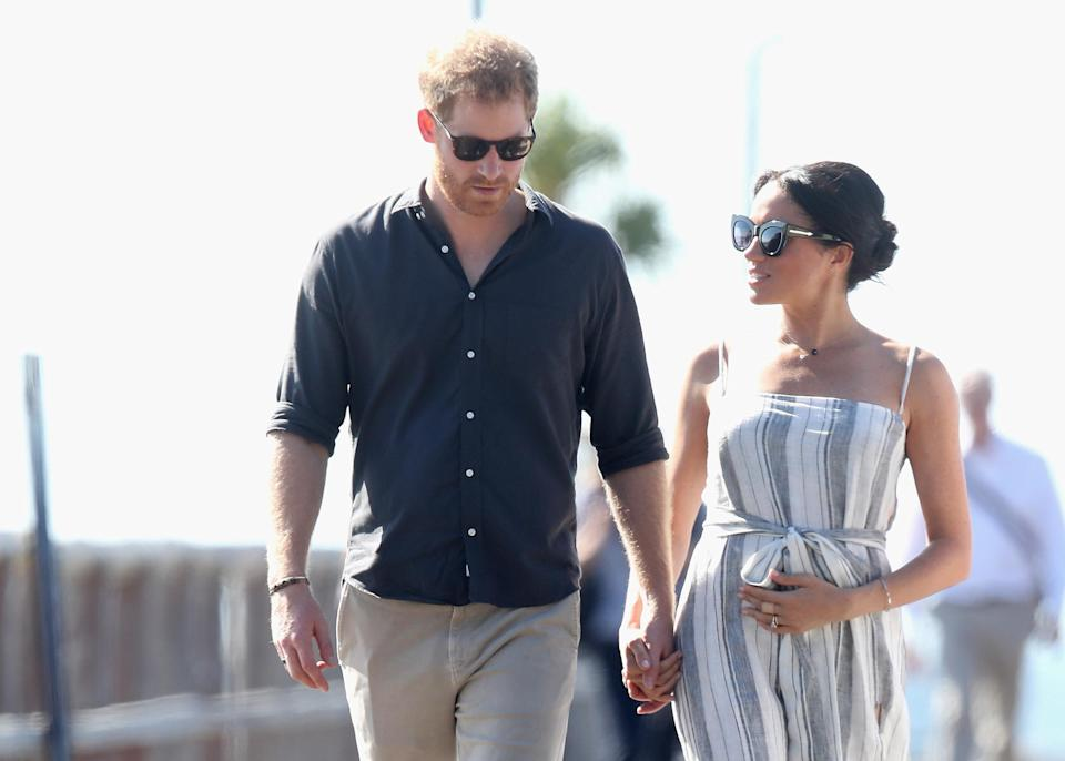 Holding your bump can make it seem more pronounced [Photo: Getty]
