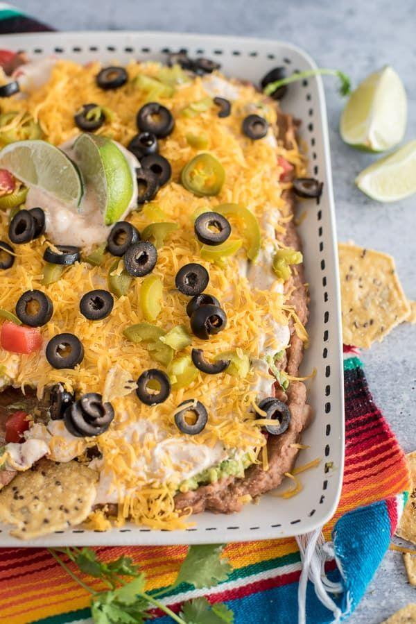 "<p>7 layers of deliciousness that we can't wait to dive into.</p><p><em><a href=""https://tidbits-marci.com/7-layer-bean-dip/"" rel=""nofollow noopener"" target=""_blank"" data-ylk=""slk:Get the recipe from Tidbits »"" class=""link rapid-noclick-resp"">Get the recipe from Tidbits »</a></em></p>"