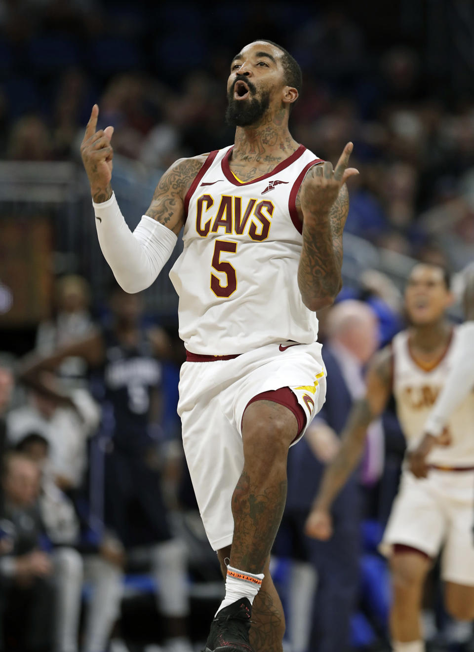 Cleveland Cavaliers' J.R. Smith celebrates after making a 3-point shot against the Orlando Magic during the second half of an NBA basketball game, Monday, Nov. 5, 2018, in Orlando, Fla. (AP Photo/John Raoux)