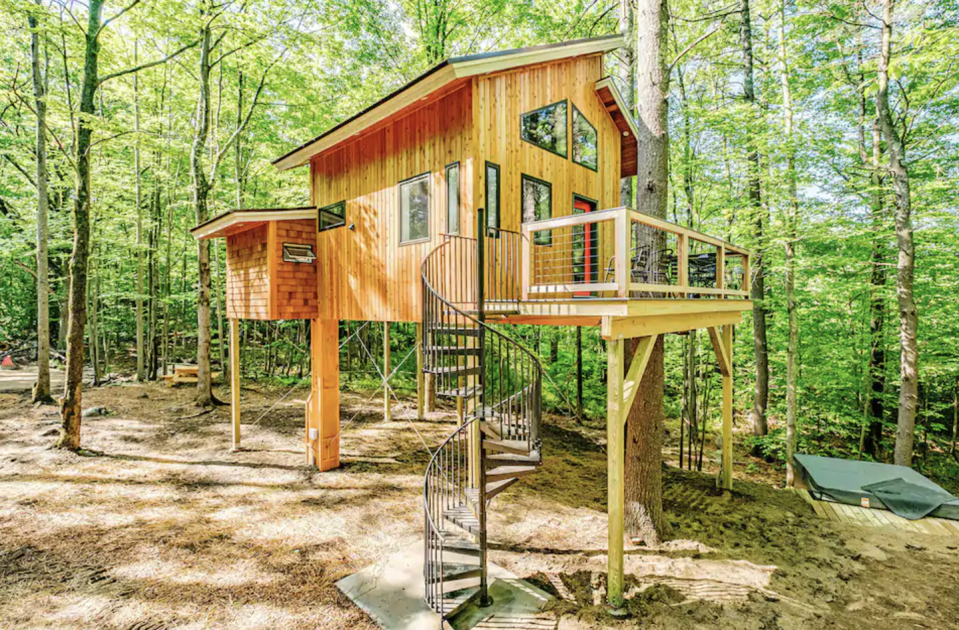 """<p><strong><a href=""""https://www.airbnb.com/rooms/41341525"""" rel=""""nofollow noopener"""" target=""""_blank"""" data-ylk=""""slk:The Canopy Treehouse"""" class=""""link rapid-noclick-resp"""">The Canopy Treehouse</a>: Sanford, Maine</strong></p><p>This beautifully designed treehouse features comfortable space inside, along with a very nice deck and an Instagram-worthy spiral staircase. It's called """"eco-luxury,"""" as the owners used recycled and reclaimed materials to build it, and it's powered by wind sources And it feels luxurious, too: it's insulated and cozy, with heating and hot water. It's quit, peaceful, and a perfect hideaway. </p>"""