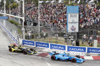 IndyCar series points leader Alex Palou (10) takes Turn 1 with Colton Herta (26) during an auto race at Grand Prix of Long Beach auto race Sunday, Sept. 26, 2021, in Long Beach, Calif. (AP Photo/Alex Gallardo)