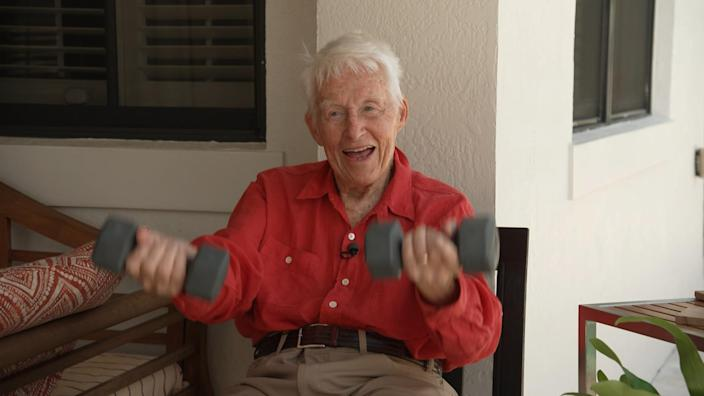 Dr. Andy Margileth, who is 101 years old, lifts weights to keep himself healthy. / Credit: CBS News
