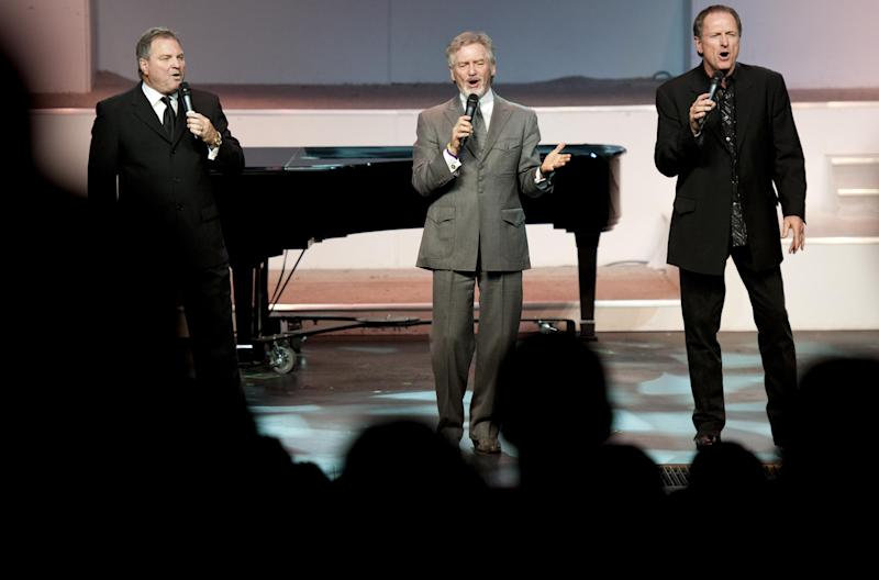 "From left, Steve Gatlin, Larry Gatlin and Rudy Gatlin of Larry Gatlin & the Gatlin Brothers sing at Andy Williams' memorial service at the Moon River Theater, in Branson, Mo., Sunday, Oct. 21, 2012. Williams, known for singing ""Moon River"" and his Christmas television specials, passed away Sept. 25. (AP Photo/Grant Hindsley)"