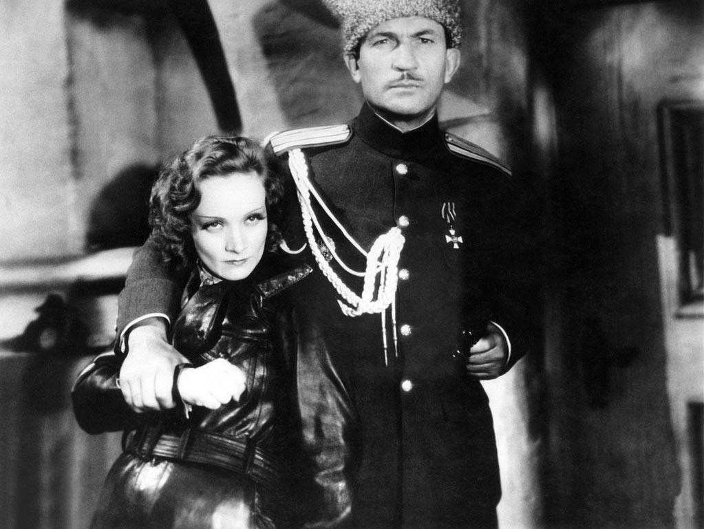 "Marlene Dietrich, ""<a href=""http://movies.yahoo.com/movie/dishonored/"">Dishonored</a>"" - In an equally larger-than-life fashion, I would like to site Marlene Dietrich in several roles, but particularly for one of her first roles with Josef von Sternberg in ""Dishonored"" (1931). She plays a withering Mata Hari opposite several men, among them her nemesis — Victor McLaglen (of all people!) in an early role as the Russian spymaster who figures out her act. It is essentially Dietrich's long looks, even more than her dialogue, that make the point. She talks with her eyes, undresses men and makes them give her what she wants. A portrait for all time."