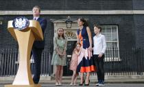 FILE - In this Wednesday, July 13, 2016 file photo Britain's Prime Minister David Cameron, speaks to the media as his wife Samantha and their children Nancy, Florence and Elwen, from left, look on as they leave 10 Downing Street, in London. Britain and the European Union have struck a provisional free-trade agreement that should avert New Year's chaos for cross-border commerce and bring a measure of certainty to businesses after years of Brexit turmoil. The breakthrough on Thursday, Dec. 24, 2020 came after months of tense and often testy negotiations that whittled differences down to three key issues: fair-competition rules, mechanisms for resolving future disputes and fishing rights. (AP Photo/Frank Augstein, File)