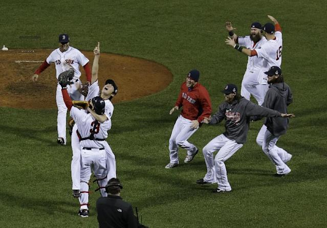 Boston Red Sox relief pitcher Koji Uehara jumps into David Ross's arms after defeating the St. Louis Cardinals in Game 6 of baseball's World Series Wednesday, Oct. 30, 2013, in Boston. The Red Sox won 6-1 to win the series. (AP Photo/Matt Slocum)