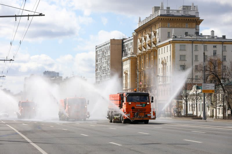 Vehicles spray disinfectant while sanitizing a road to prevent the spread of the coronavirus disease in Moscow