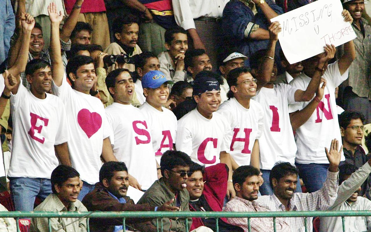 BANGALORE, INDIA:  Indian fans cheer for batsman Sachin Tendulkar during the pre-lunch session on the third day of the final test match between India and England in Bangalore 21 December 2001. India were 149 for 5 at lunch with Tendulkar on 77 and Sehwag on 20. AFP PHOTO/INDRANIL MUKHERJEE (Photo credit should read INDRANIL MUKHERJEE/AFP/Getty Images)