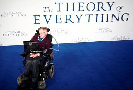 "FILE PHOTO: Stephen Hawking arrives at the UK premiere of the film ""The Theory of Everything"" which is based around his life, at a cinema in central London, Britain, December 9, 2014. REUTERS/Andrew Winning/File Photo"