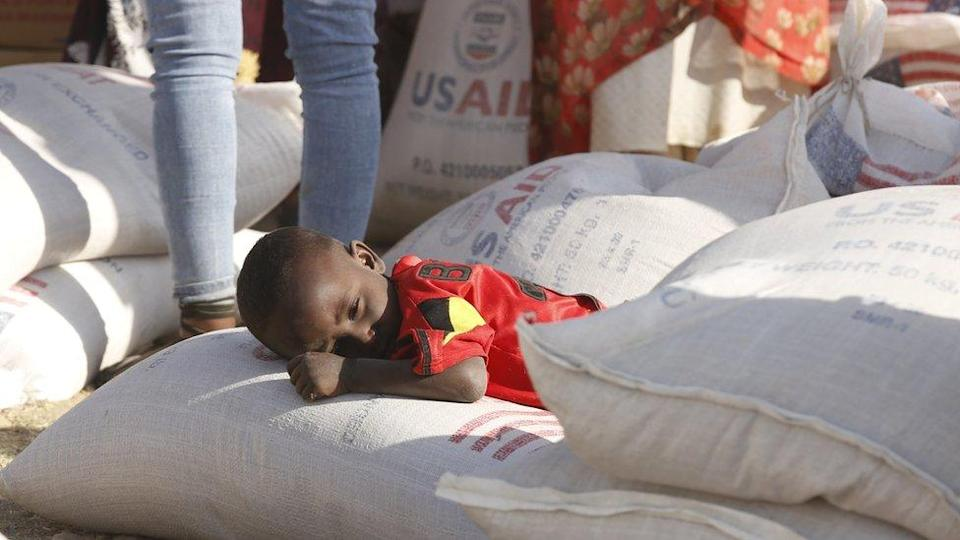 Tigray people, fled due to conflicts and taking shelter in Mekelle city of the Tigray region, in northern Ethiopia, receive the food aid distributed by United States Agency for International Development (USAID) on March 8, 2021.