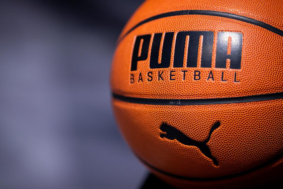 14 February 2019, Bavaria, Herzogenaurach: A basketball with the logo of the sporting goods manufacturer Puma SE is exhibited in the company. On 14 February, the sporting goods manufacturer will present its balance sheet for the year 2018. Photo: Daniel Karmann/dpa (Photo by Daniel Karmann/picture alliance via Getty Images)