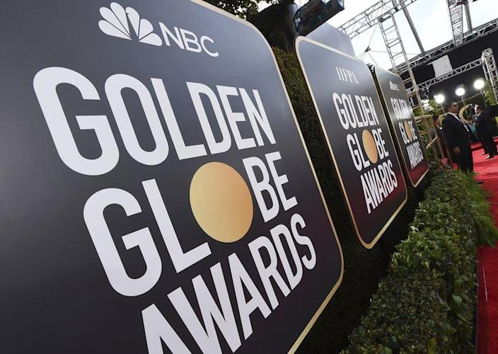 Event signage appears above the red carpet at the 77th annual Golden Globe Awards, on Jan. 5, 2020, in Beverly Hills, Calif. The 78th annual Golden Globes will be held on Sunday, Feb. 18, 2021. (Photo by Jordan Strauss/Invision/AP, File)
