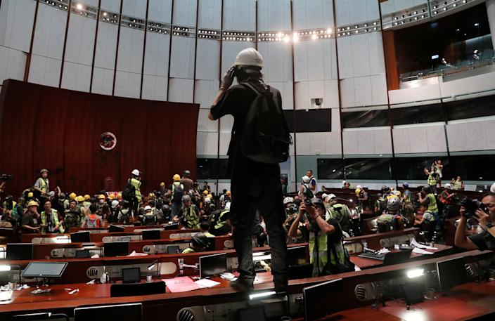 Protesters are seen inside a chamber after they broke into the Legislative Council building during the anniversary of Hong Kong's handover to China in Hong Kong, China July 1, 2019. (Photo: Tyrone Siu/Reuters)