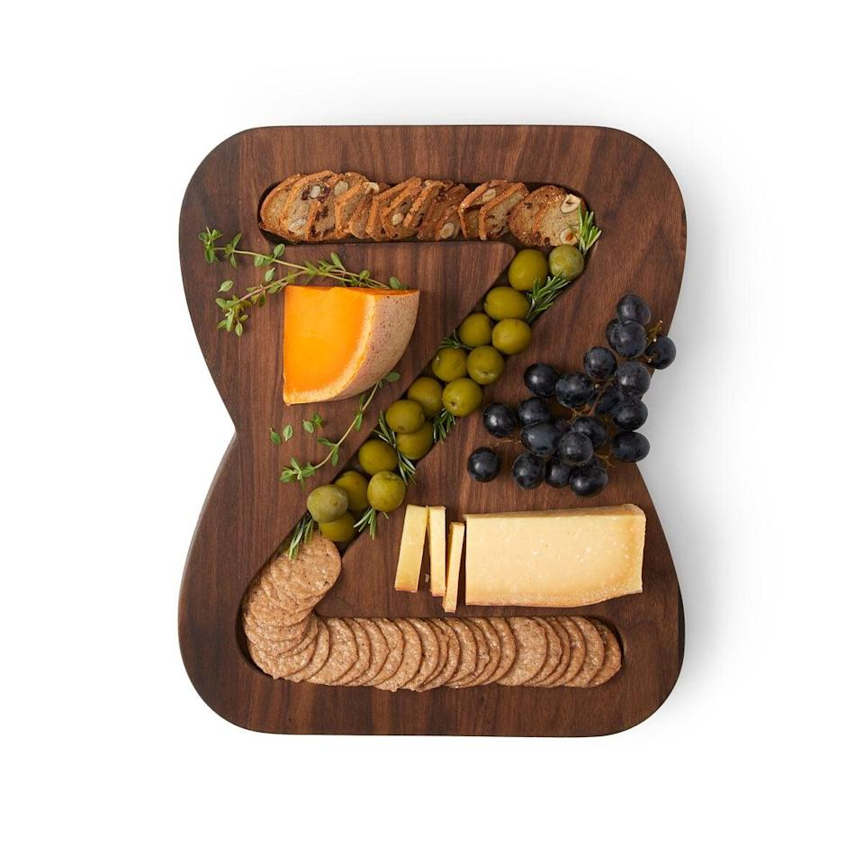 <p>This <span>Monogram Cheese &amp; Crackers Serving Board</span> ($85) is so unique.</p>