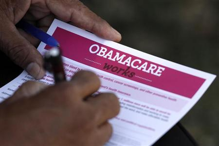 A man fills out an information card during an Affordable Care Act outreach event hosted by Planned Parenthood for the Latino community in Los Angeles, California