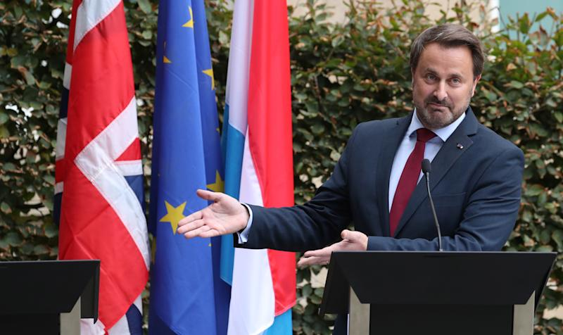Luxembourg's Prime Minister Xavier Bettel gestures at the space left for Boris Johnson after the Prime Minister pulled out of a news conference (Reuters)