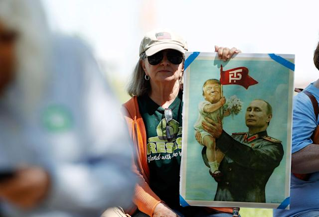 <p>Jeanette Martin of Longmont, Colo., holds up a placard during a protest against the polices of President Donald Trump Saturday, June 3, 2017, in downtown Denver. (Photo: David Zalubowski/AP) </p>