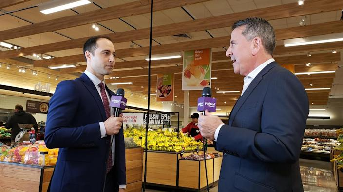 Yahoo Finance anchor Brian Sozzi (left) speaks with Target CEO Brian Cornell (right) inside a newly renovated Target grocery department at a Minneapolis store.