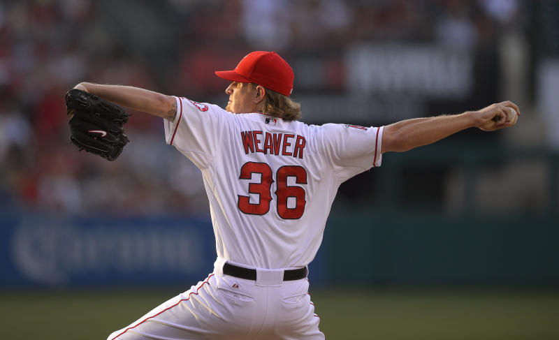 Los Angeles Angels starting pitcher Jered Weaver throws to the plate during the first inning of their baseball game against the St. Louis Cardinals, Tuesday, July 2, 2013, in Anaheim, Calif. (AP Photo/Mark J. Terrill)
