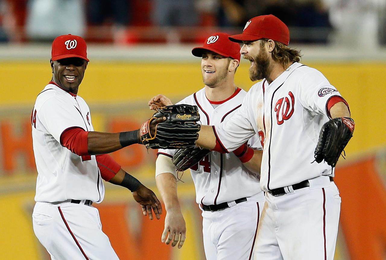 WASHINGTON, DC - SEPTEMBER 20: Roger Bernadina #2 (L), Bryce Harper #34 (C), and Jayson Werth #28 of the Washington Nationals celebrate after the Nationals defeated the Los Angeles Dodgers 4-1 to clinch a playoff birth at Nationals Park on September 20, 2012 in Washington, DC.  (Photo by Rob Carr/Getty Images)