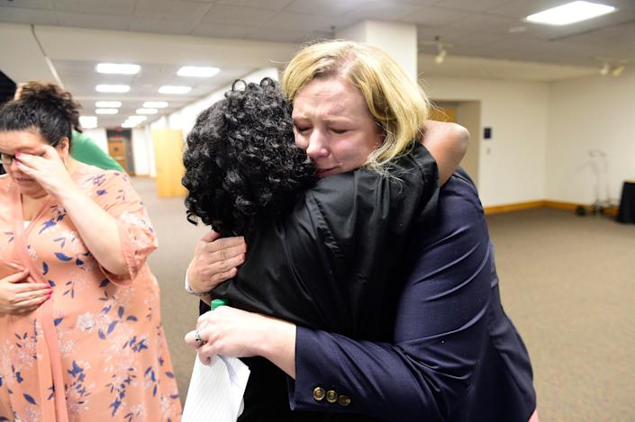 Dayton Mayor Nan Whaley (R) is consoled by a member of the religious community moments after her press conference on a shooting in the Oregon District of Dayton, Ohio on August 4, 2019. (Photo: Tom Russo/EPA-EFE/Shutterstock)