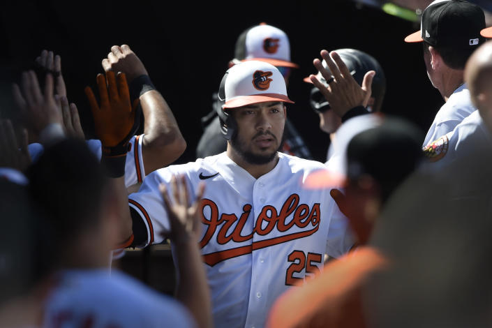 Baltimore Orioles' Anthony Santander is congratulated after hitting a two run home run against the Texas Rangers in the fourth inning of a baseball game Sunday, Sept. 26, 2021, in Baltimore. (AP Photo/Gail Burton)