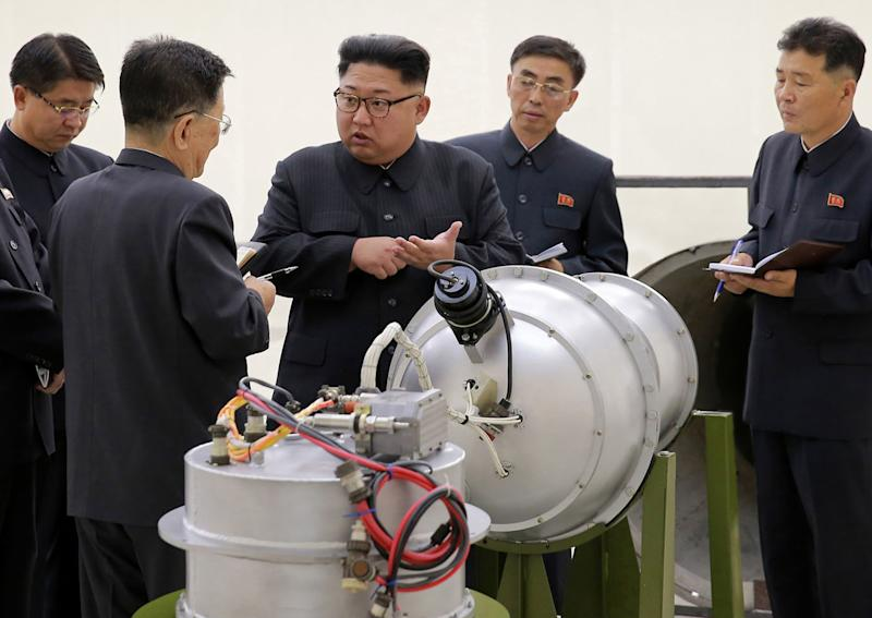 North Korean leader Kim Jong-un inspects a weapon in North Korea. (AP)