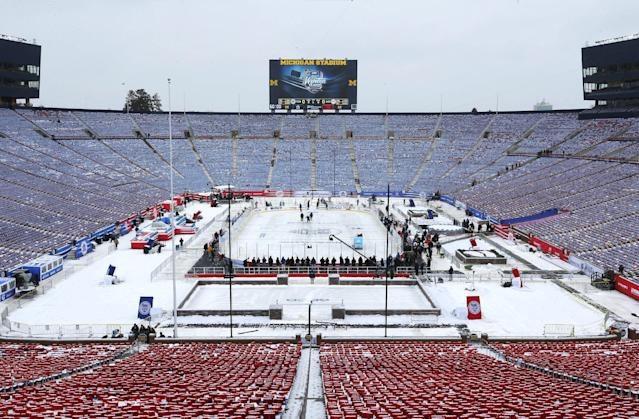 The hockey rink in Michigan Stadium is shown for the NHL Winter Classic outdoor hockey game between the Detroit Red Wings and Toronto Maple Leafs Tuesday, Dec. 31, 2013, in Ann Arbor, Mich. The game is scheduled for New Year's Day. (AP Photo/Paul Sancya)