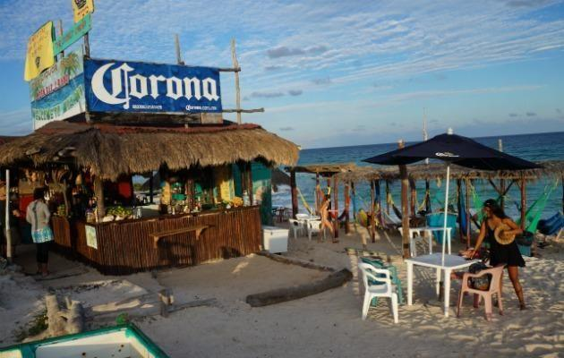 The Coconut Cabana, a beach bar on the island of Cozumel that looks straight out of a Corona commercial.