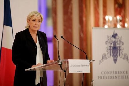 Marine Le Pen, French National Front (FN) political party leader and candidate for French 2017 presidential election, attends a news conference in Paris