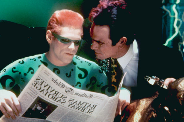 Jim Carrey and Tommy Lee Jones as the Riddler and Two-Face in <em>Batman Forever</em>. (Photo: Warner Bros./courtesy Everett Collection)