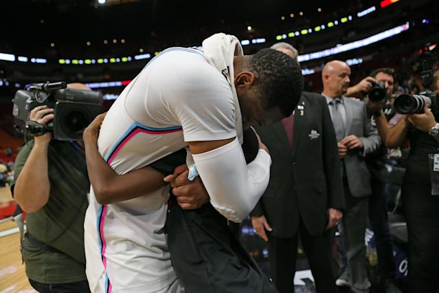 Dwyane Wade hugs Zaya Wade after a 2018 game. (David Santiago/El Nuevo Herald/Tribune News Service via Getty Images)